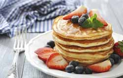 Pancakes with Strawberries and Maple Syrup